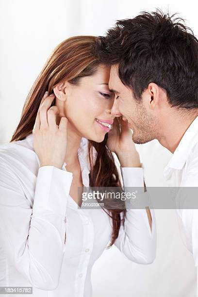 Portrait of young couple about to kiss