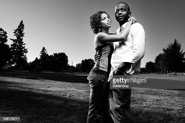 Portrait of Young Couple Embracing Outside, Black and White