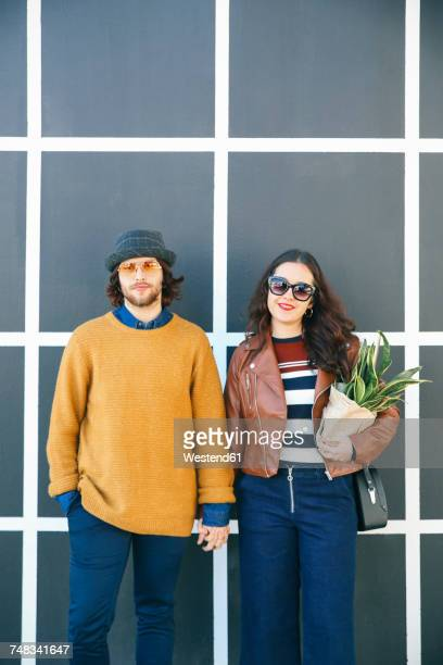 Portrait of young couple hand in hand