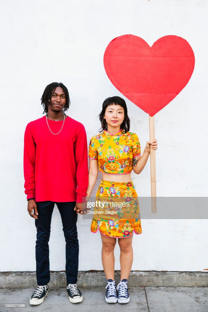 Portrait of young couple holding hands : Stock Photo