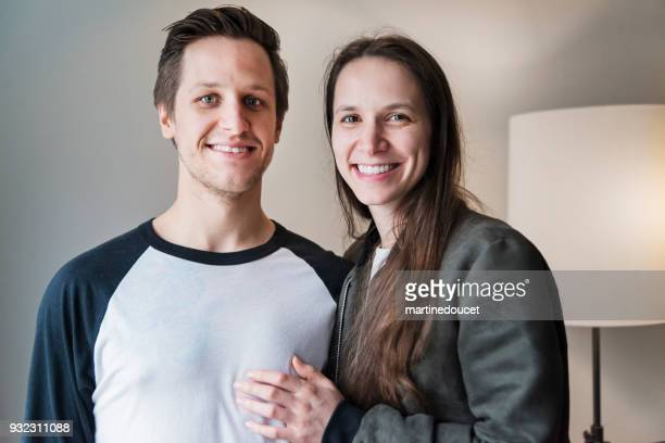 "portrait of young couple in their twenties at home. - ""martine doucet"" or martinedoucet stock pictures, royalty-free photos & images"