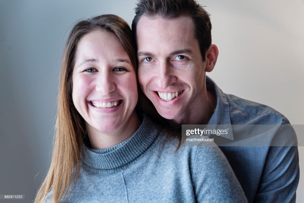 Portrait of young couple in their twenties at home. : Stock Photo