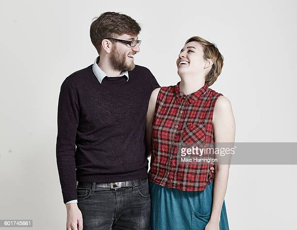 portrait of young couple laughing - dos personas fotografías e imágenes de stock