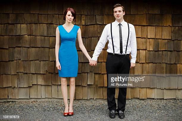 portrait of young couple - 前にいる ストックフォトと画像