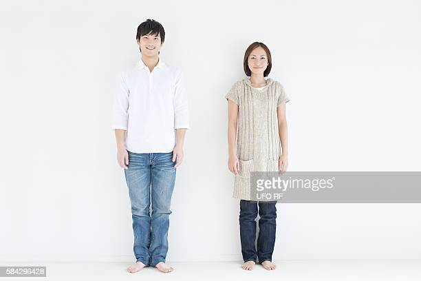 portrait of young couple - 大人 ストックフォトと画像