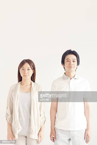 portrait of young couple - ポロシャツ ストックフォトと画像