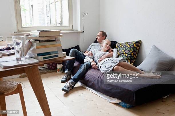 Portrait of young couple relaxing on sofa