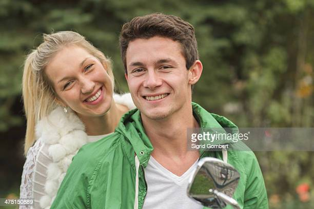 portrait of young couple sitting on vespa - sigrid gombert stock pictures, royalty-free photos & images