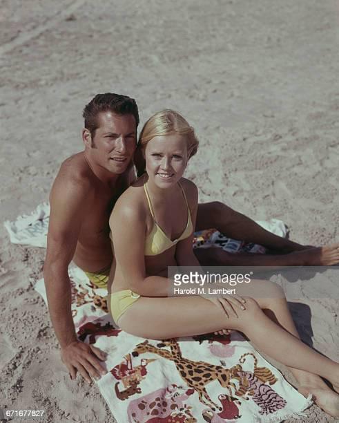 Portrait Of Young Couple Sunbathing