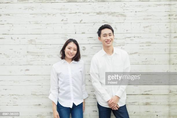 portrait of young couple wearing white shirt - 白いシャツ ストックフォトと画像