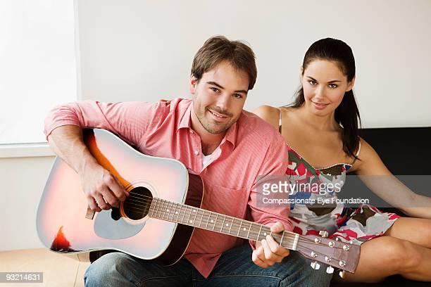 "portrait of young couple with a guitar - ""compassionate eye"" fotografías e imágenes de stock"