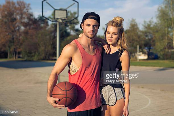 portrait of young couple with basketball