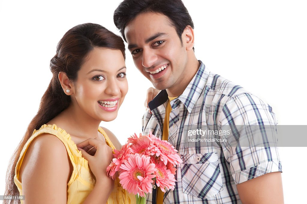 Portrait of young couple with flowers : Stock Photo