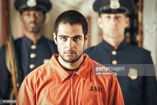 portrait of young criminal in prison - criminal stock pictures, royalty-free photos & images