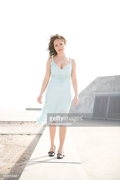 Portrait of young Danish woman, 26 years old, outdoors in a light colored dress at Amager Strandpark, Copenhagen, Denmark