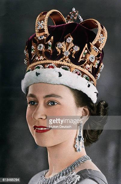 A portrait of young Elizabeth II of Great Britain and Northern Ireland wearing the crown of the kings and queens of England for her coronation in...