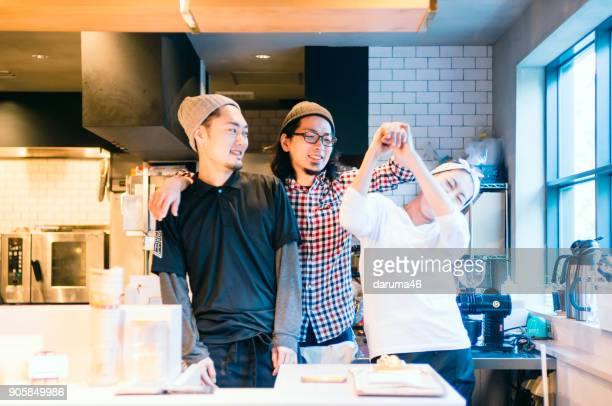 Portrait of Young Employees Working at Coffee Shop