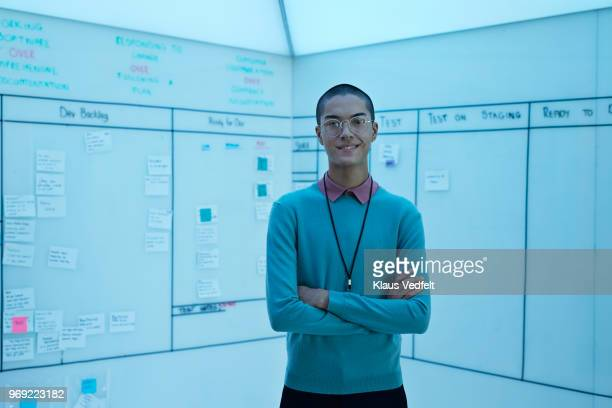 portrait of young entrepreneur in front of creative whiteboard - non binary gender stock pictures, royalty-free photos & images