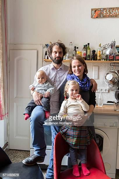 portrait of young family at home. - homens de idade mediana imagens e fotografias de stock