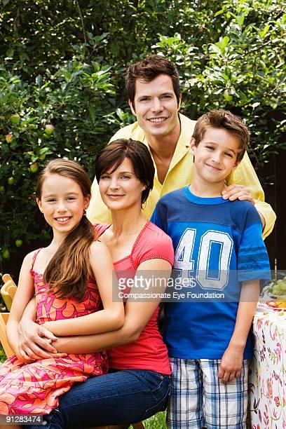 "portrait of young family - ""compassionate eye"" fotografías e imágenes de stock"