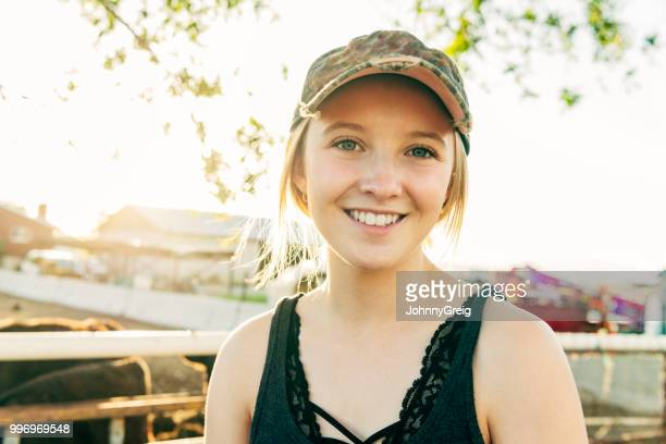 portrait of young farm worker smiling - 16 17 jahre stock pictures, royalty-free photos & images