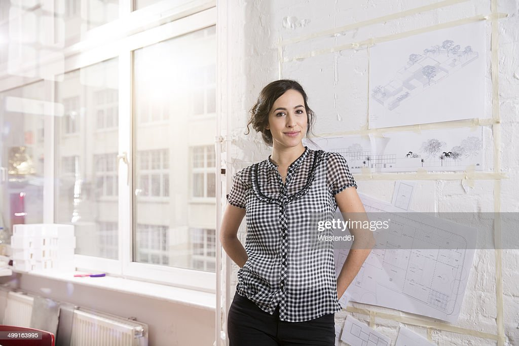 portrait of young female architect in office ストックフォト getty