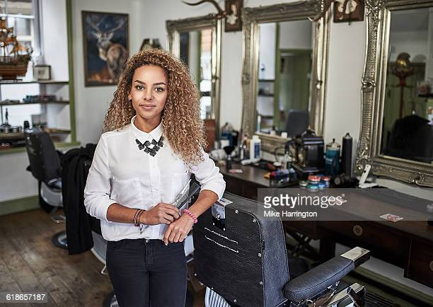 Portrait of young female barber