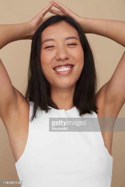 portrait of young female chinese woman - armpit woman stock pictures, royalty-free photos & images