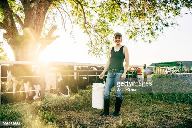 portrait of young female farm worker with cattle - young animal stock pictures, royalty-free photos & images