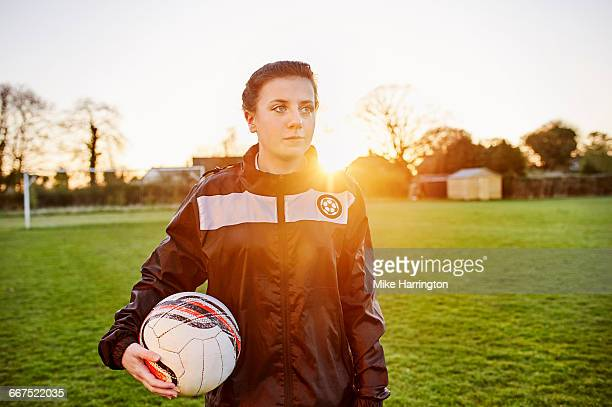 Portrait of young female footballer