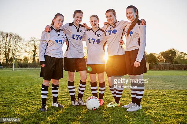 portrait of young female footballers - leanincollection stock pictures, royalty-free photos & images