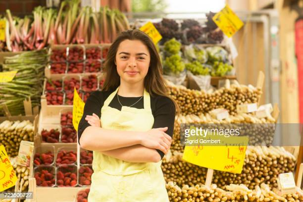 portrait of young female fruit and veg stall trader - sigrid gombert stock pictures, royalty-free photos & images