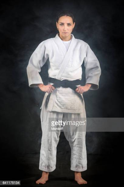 portrait of young female judo master - judo stock pictures, royalty-free photos & images