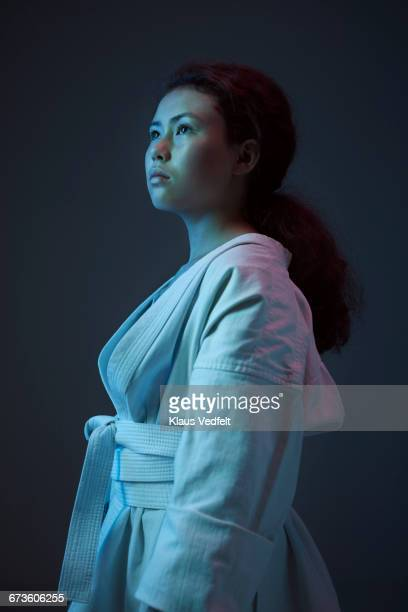 portrait of young female martial arts athlete - forward athlete stock pictures, royalty-free photos & images