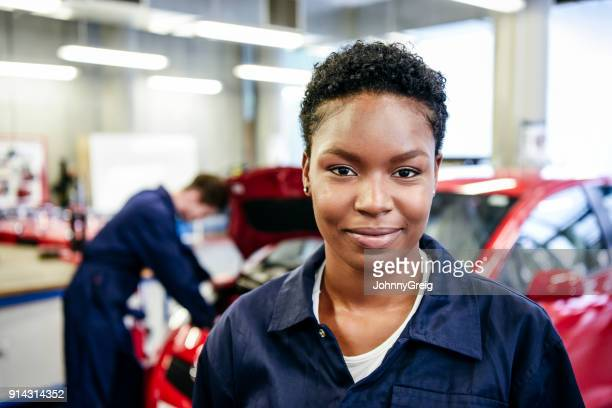 portrait of young female mechanic - black jumpsuit stock photos and pictures