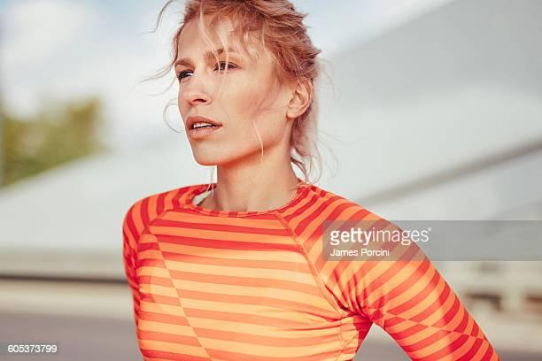 Portrait of young female runner taking a break