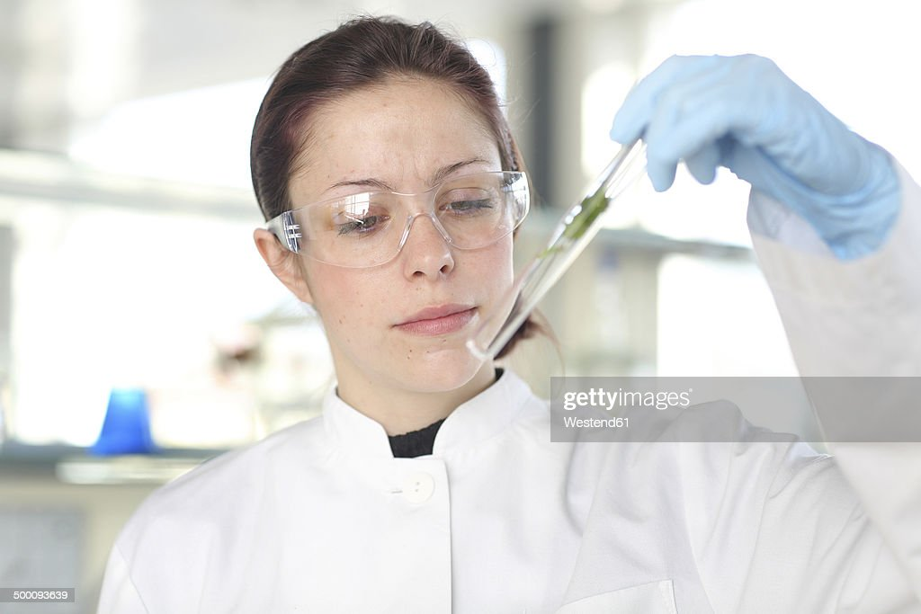 Portrait Of Young Female Scientist At Work In Lab Stock Photo