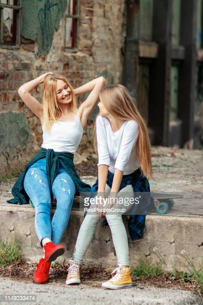 portrait of young female skateboarders - funky stock pictures, royalty-free photos & images