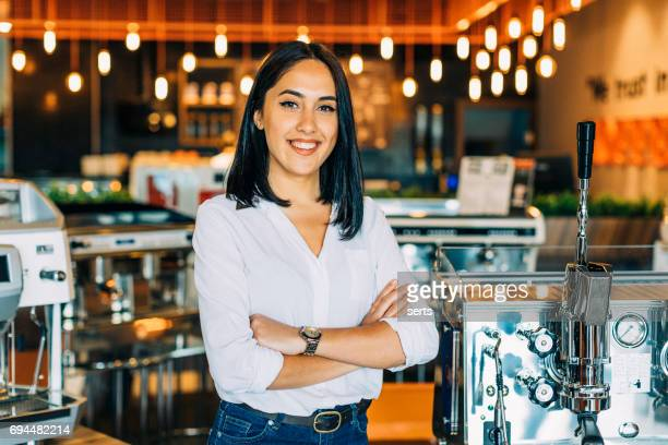 portrait of young female small business owner in a her shop - building story stock pictures, royalty-free photos & images