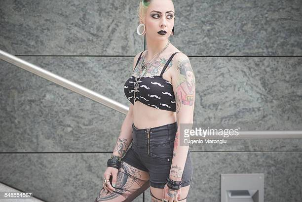 portrait of young female tattooed punk on subway stairs - crop top stock pictures, royalty-free photos & images