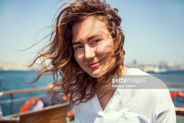 Portrait of young female tourist on passenger ferry deck, Beyazit, Turkey