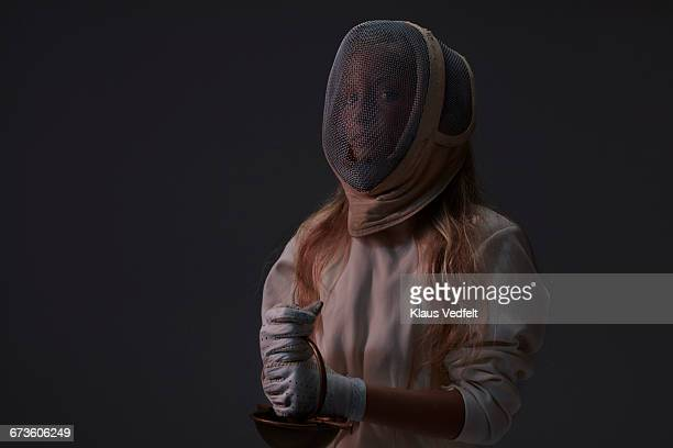 Portrait of young fencer wearing mask