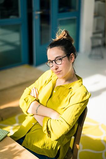 Portrait of young freelancer sitting at desk in her studio - gettyimageskorea