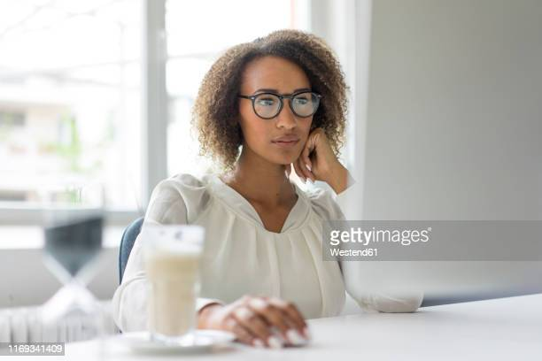 portrait of young freelancer working at desk - blouse stock pictures, royalty-free photos & images