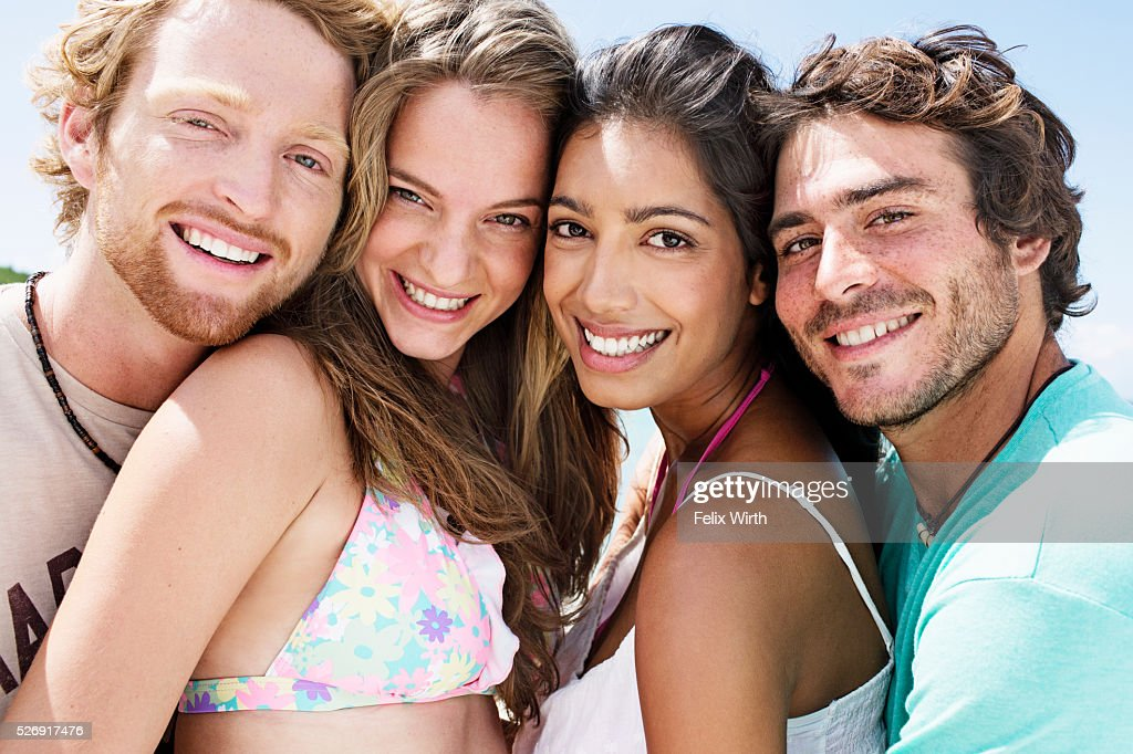 Portrait of young friends smiling outdoors : Stock Photo