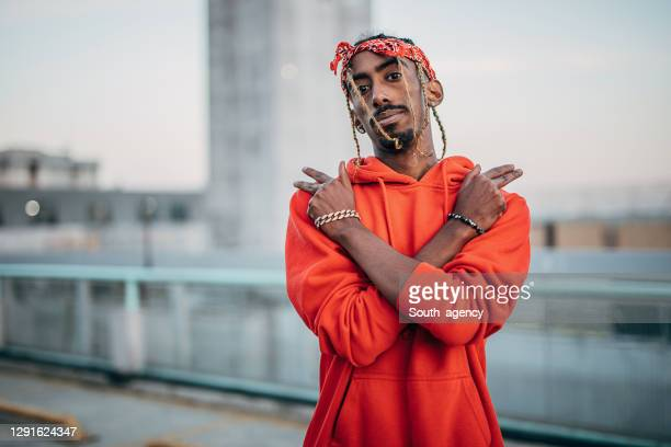 portrait of young gangsta rapper outdoors in the city - rapper stock pictures, royalty-free photos & images