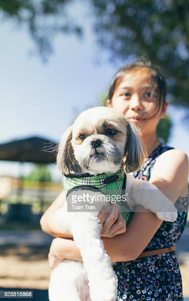 Portrait of young girl and her dog