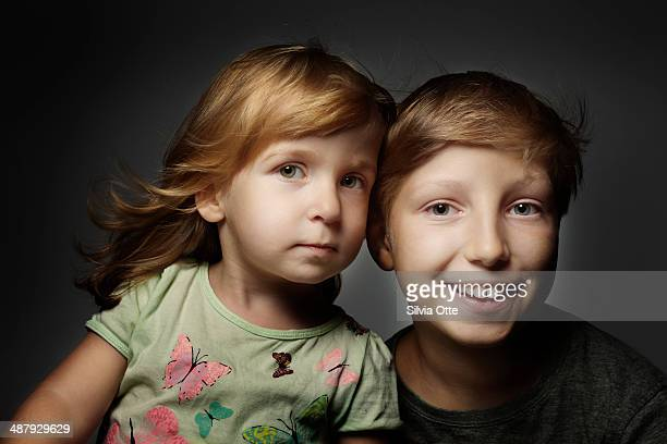 Portrait of young girl and older boy