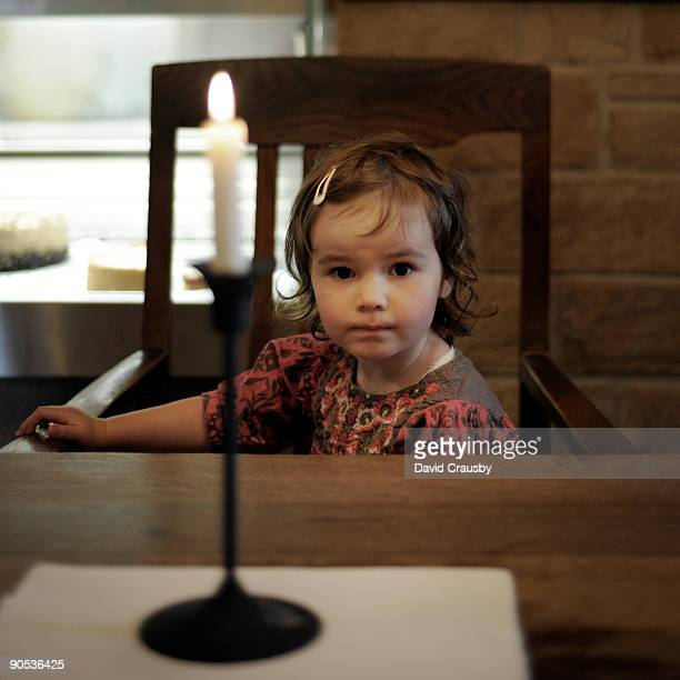 portrait of young girl at a table - crausby stock pictures, royalty-free photos & images