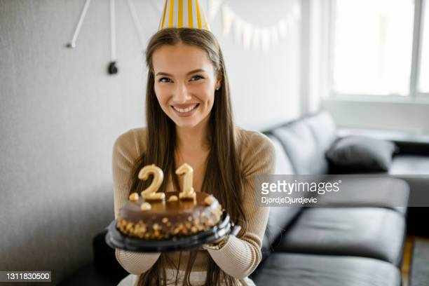 portrait of young girl celebrating her 21st birthday at home - 21st birthday stock pictures, royalty-free photos & images